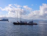 Coast Guard boat alongside anchored boat