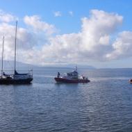 Coast Guard boats and anchored boat