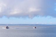 Coast Guard boats racing to the scene