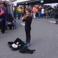 Riley plays his violin at the Farmer's Market