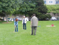 Renee, Sherri, and Todd play croquet