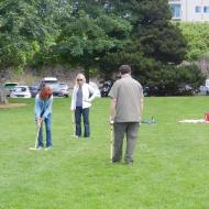 Renee, Sherri, and Todd play croquet