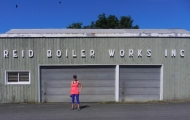 Ms. Reid in front of Reid's Boulder Works