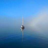 boat floating in blue