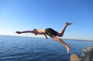 Yuval jumping into the bay.