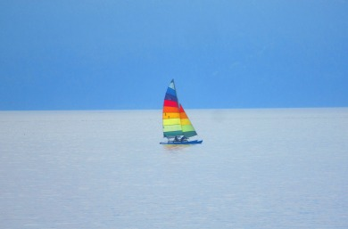 Rainbow Sailboat on Bellingham Bay (photo by karen Molenaar Terrell)