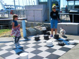 Barb and her grand-daughter playing checkers.