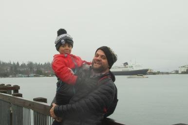 A family enjoys a rainy day on the Bellingham boardwalk.